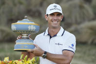 Billy Horschel holds his trophy after winning the Dell Technologies Match Play Championship golf tournament Sunday, March 28, 2021, in Austin, Texas. (AP Photo/David J. Phillip)