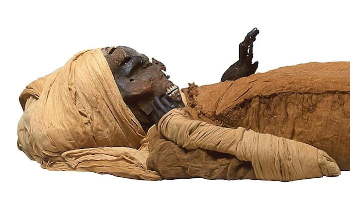 A handout picture released by the Egyptian Ministry of Tourism and Antiquities on February 17, 2021 shows a view of the mummy of ancient Egyptian King Seqenenre-Taa-II - AFP/AFP