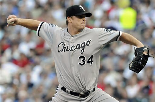 Chicago White Sox pitcher Gavin Floyd throws against the Minnesota Twins in the first inning of a baseball game, Tuesday, June 26, 2012, in Minneapolis. (AP Photo/Jim Mone)