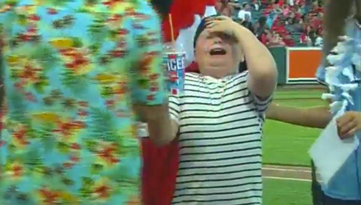 This kid at the Memphis Redbirds game won the Icee Chugging Contest, but wasn't able to prevent the dreaded brain freeze. (Twitter/@memphisredbirds)