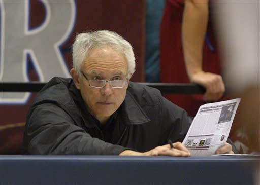 Los Angeles Lakers general manager Mitch Kupchak watches Loyola Marymount play Gonzaga in an NCAA college basketball game, Thursday, Jan. 31, 2013, in Los Angeles. Gonzaga won 88-43. (AP Photo/Mark J. Terrill)