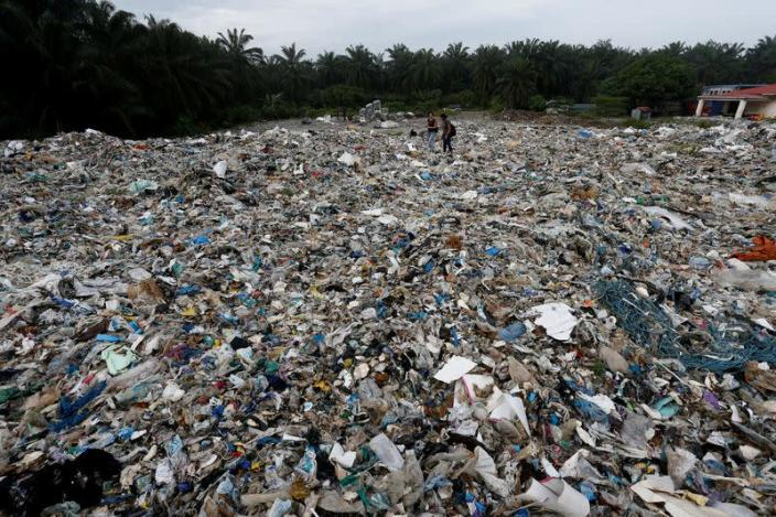 FILE PHOTO: Plastic waste piled outside an illegal recycling factory in Jenjarom, Kuala Langat