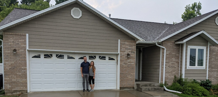 Melissa and Ryan George in front of their new house in Salem, Utah.