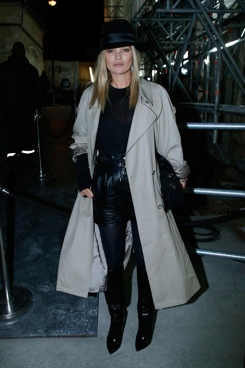 <p>Kate Moss covered up in a beige trench coat. <i>[Photo: Getty]</i> </p>
