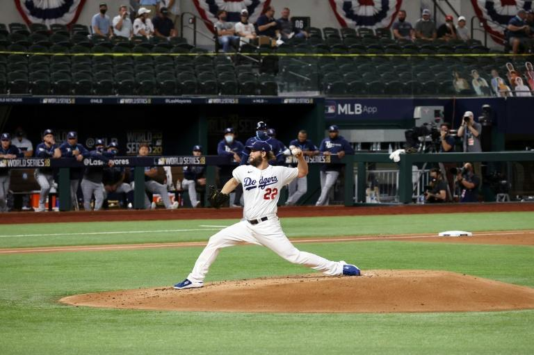 Clayton Kershaw's superb pitching display set up the Los Angeles Dodgers' 8-3 victory in game one of the World Series against the Tampa Bay Rays