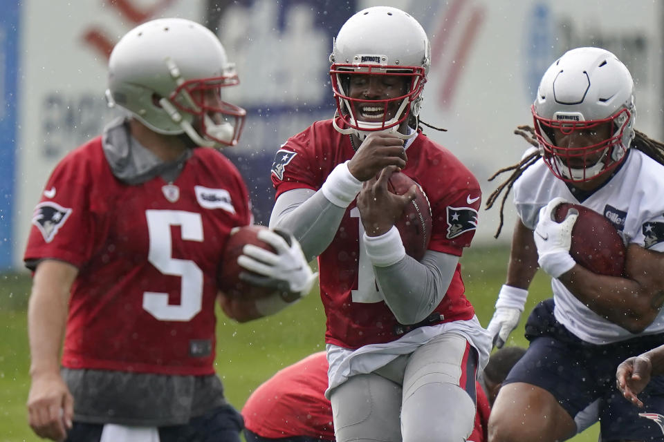 New England Patriots quarterbacks Brian Hoyer (5) and Cam Newton (1) and tight end Jakob Johnson, right, perform field drills during an NFL football practice, Monday, June 14, 2021, in Foxborough, Mass. (AP Photo/Steven Senne)