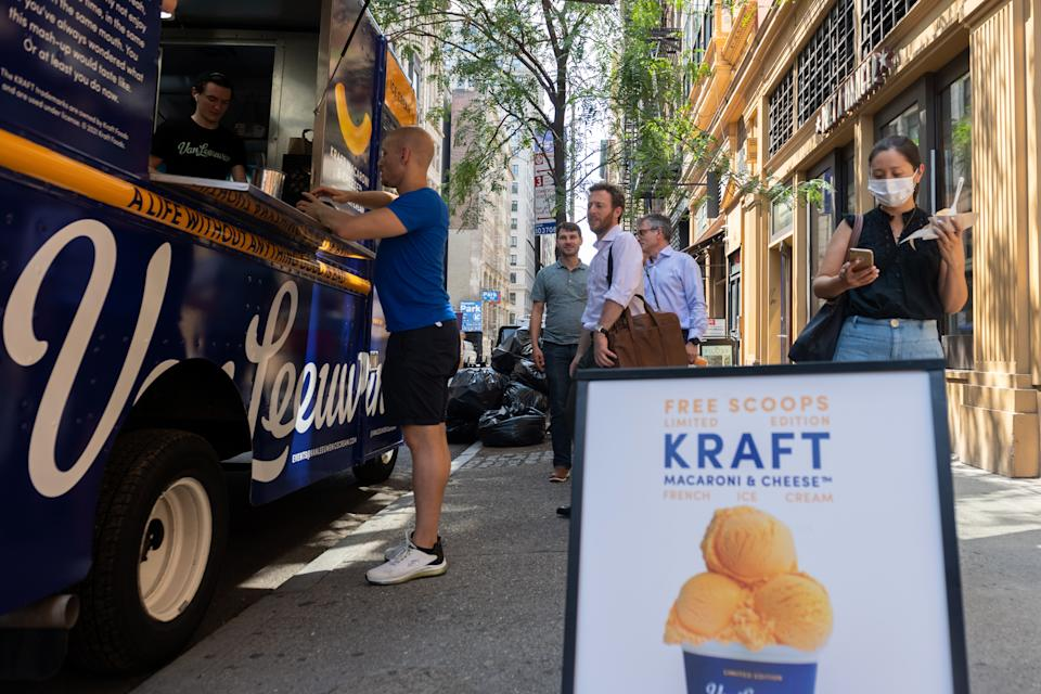 People line up to try Van Leeuwen's new Kraft mac and cheese flavor ice cream at a pop-up truck near Union Square on July 14, 2021 in New York City. (Photo by Alexi Rosenfeld/Getty Images)