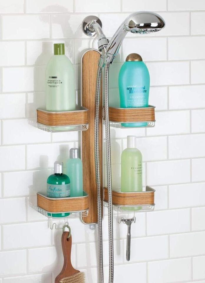 "<p>The bamboo detail on this <a href=""https://www.popsugar.com/buy/mDesign-Metal-Hanging-Bath-Shower-Caddy-Storage-Organizer-488308?p_name=mDesign%20Metal%20Hanging%20Bath%20and%20Shower%20Caddy%20Storage%20Organizer&retailer=amazon.com&pid=488308&price=30&evar1=casa%3Aus&evar9=46583359&evar98=https%3A%2F%2Fwww.popsugar.com%2Fphoto-gallery%2F46583359%2Fimage%2F46585400%2FmDesign-Metal-Hanging-Bath-Shower-Caddy-Storage-Organizer&list1=shopping%2Corganization%2Chome%20organization%2Chome%20shopping&prop13=api&pdata=1"" rel=""nofollow"" data-shoppable-link=""1"" target=""_blank"" class=""ga-track"" data-ga-category=""Related"" data-ga-label=""https://www.amazon.com/mDesign-Hanging-Shower-Storage-Organizer/dp/B01M647EU7?ref_=ast_sto_dp"" data-ga-action=""In-Line Links"">mDesign Metal Hanging Bath and Shower Caddy Storage Organizer</a> ($30) makes it look so nice.</p>"