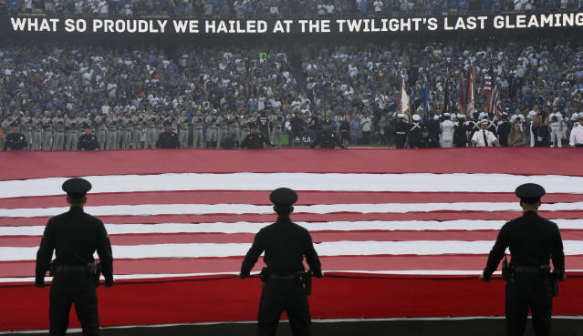 <p>General view during the singing of the national anthem before game one of the 2017 World Series between the Los Angeles Dodgers and the Houston Astros at Dodger Stadium. Mandatory Credit: Robert Hanashiro-USA TODAY Sports </p>