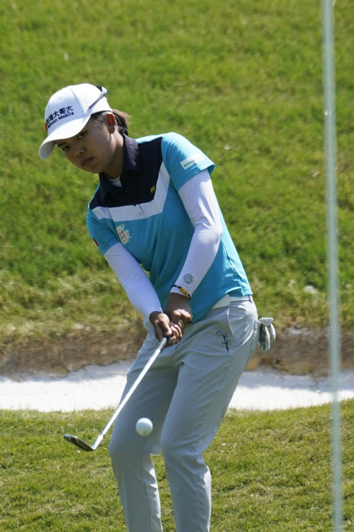 Wei-Ling Hsu, of Taiwan, chips to the eighth hole during the final round of the LPGA Tour's Pure Silk Championship golf tournament in Williamsburg, Va., Sunday, May 23, 2021. (AP Photo/Steve Helber)
