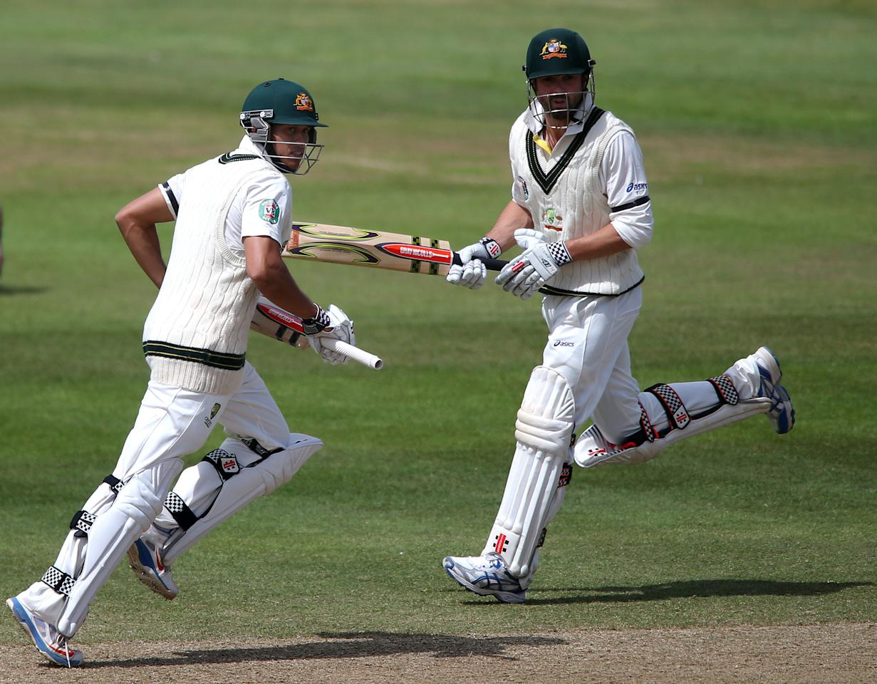 Australia batsman Usman Kkawaja (left) takes a run with teammate Ed Cowan during the International Tour match at the County Ground, Taunton.