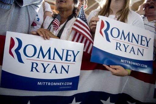 "<p>Supporters hold campaign signs as US Republican presidential candidate Mitt Romney and his running mate Paul Ryan speak at a campaign rally in Manassas, Virginia, on August 11. Mitt Romney and newly minted running mate Paul Ryan hit the road on a bus tour across must-win US states Saturday, selling themselves to voters as the duo who can win the White House and ""save the American dream.""</p>"
