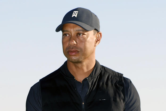 "FILE - Tiger Woods looks on during the trophy ceremony on the practice green after the final round of the Genesis Invitational golf tournament at Riviera Country Club, Sunday, Feb. 21, 2021, in the Pacific Palisades area of Los Angeles. Woods was injured Tuesday, Feb. 23, 2021, in a vehicle rollover in Los Angeles County and had to be extricated from the vehicle with the ""jaws of life"" tools, the Los Angeles County Sheriff's Department said.(AP Photo/Ryan Kang)"