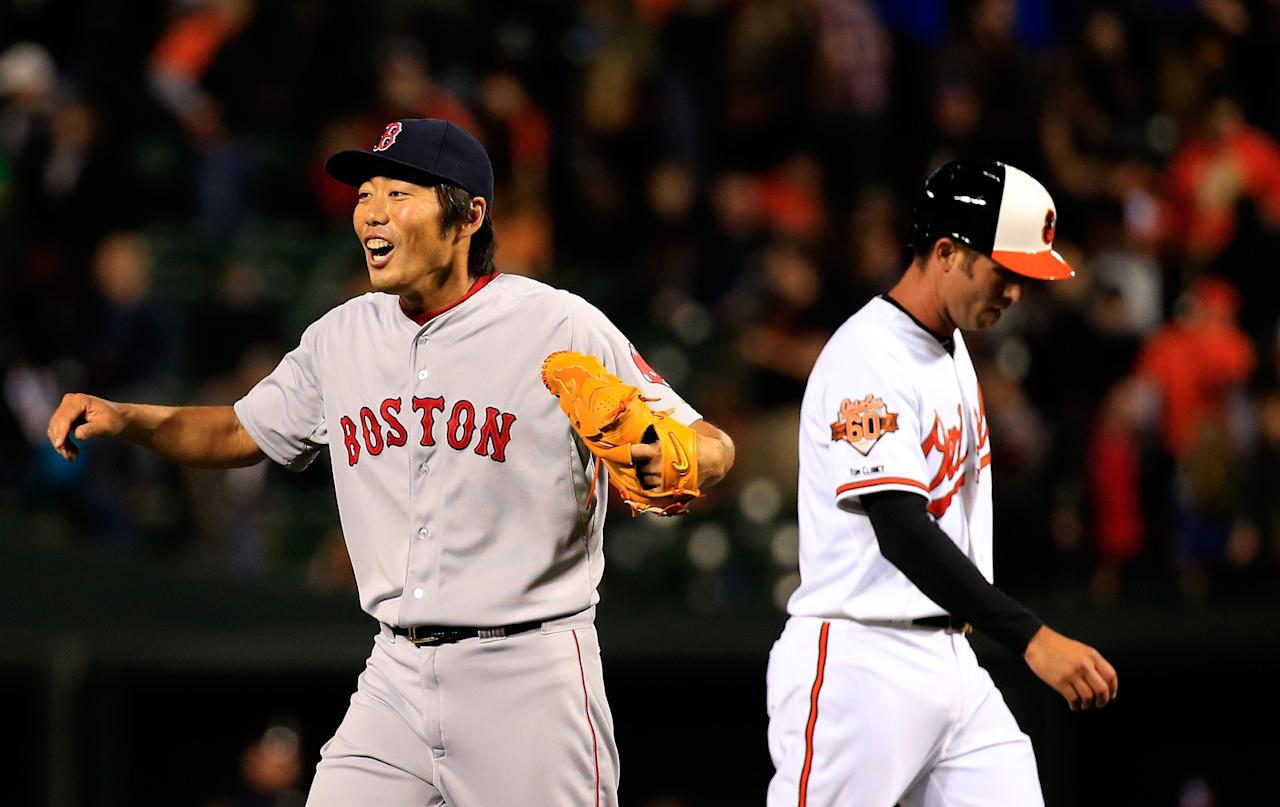 BALTIMORE, MD - APRIL 02: Koji Uehara #19 of the Boston Red Sox celebrates in front of J.J. Hardy #2 of the Baltimore Orioles following the Red Sox 6-2 win at Oriole Park at Camden Yards on April 2, 2014 in Baltimore, Maryland. (Photo by Rob Carr/Getty Images)