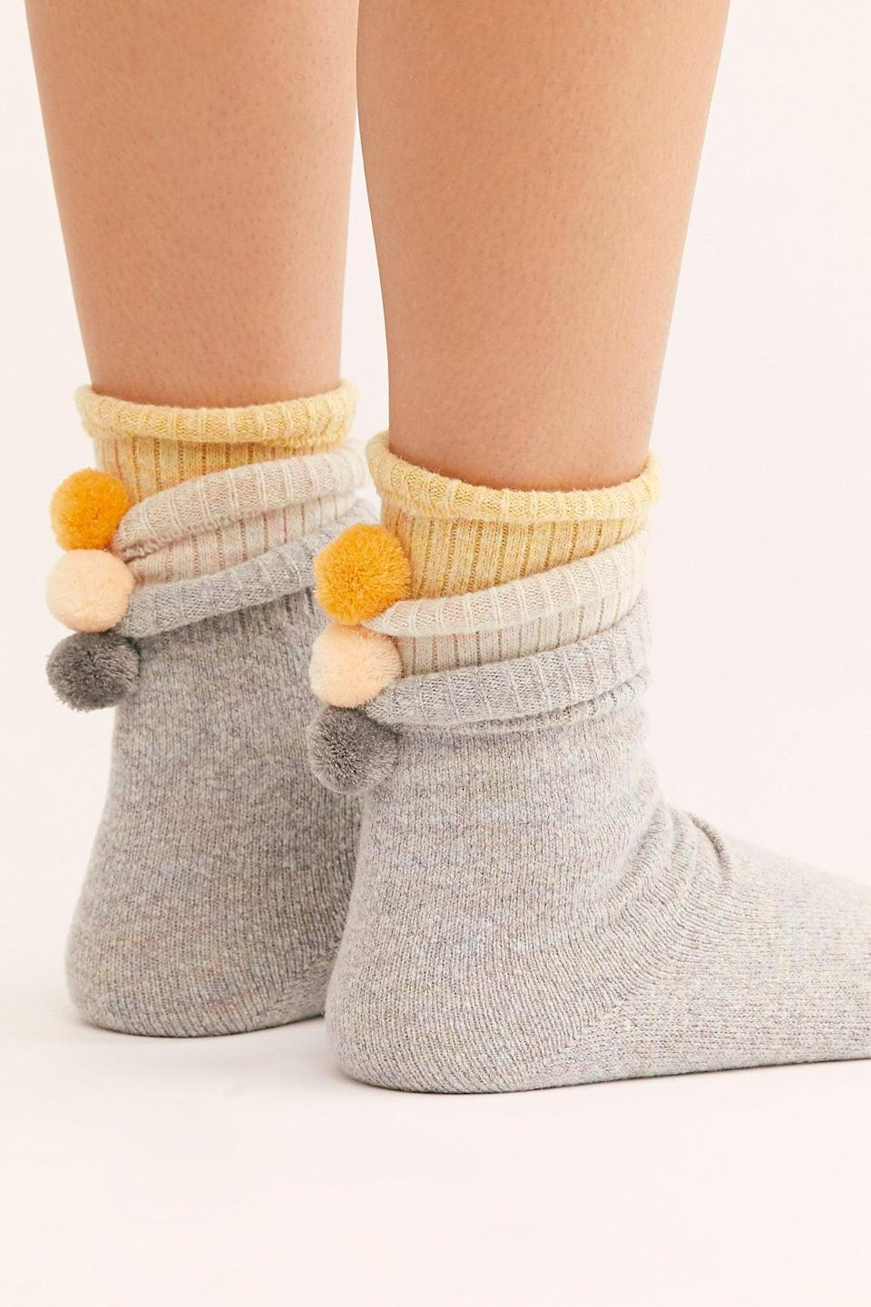 """<p>We want these <a href=""""https://www.popsugar.com/buy/Nat-Pom-Pom-Crew-Socks-524365?p_name=Nat%20Pom%20Pom%20Crew%20Socks&retailer=freepeople.com&pid=524365&price=28&evar1=fab%3Aus&evar9=45460327&evar98=https%3A%2F%2Fwww.popsugar.com%2Fphoto-gallery%2F45460327%2Fimage%2F46977958%2FNat-Pom-Pom-Crew-Socks&list1=shopping%2Cgifts%2Cfree%20people%2Choliday%2Cgift%20guide%2Cgifts%20for%20women&prop13=api&pdata=1"""" class=""""link rapid-noclick-resp"""" rel=""""nofollow noopener"""" target=""""_blank"""" data-ylk=""""slk:Nat Pom Pom Crew Socks"""">Nat Pom Pom Crew Socks</a> ($28) for ourselves.</p>"""