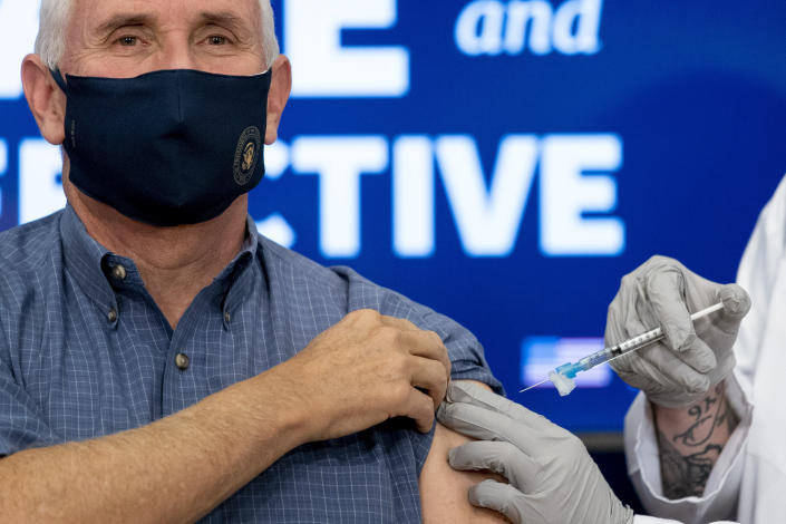 Vice President Mike Pence receives a Pfizer-BioNTech COVID-19 vaccine shot at the Eisenhower Executive Office Building on the White House complex, Friday, Dec. 18, 2020, in Washington. Karen Pence, and U.S. Surgeon General Jerome Adams also participated. (AP Photo/Andrew Harnik)