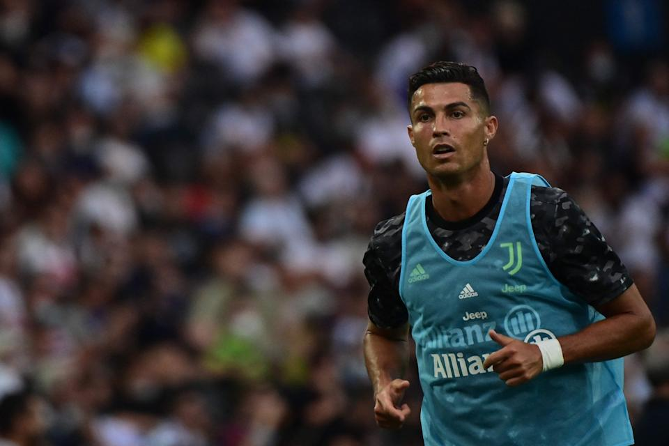 Cristiano Ronaldo warms up during the Italian Serie A football match between Udinese and Juventus on Aug. 22.