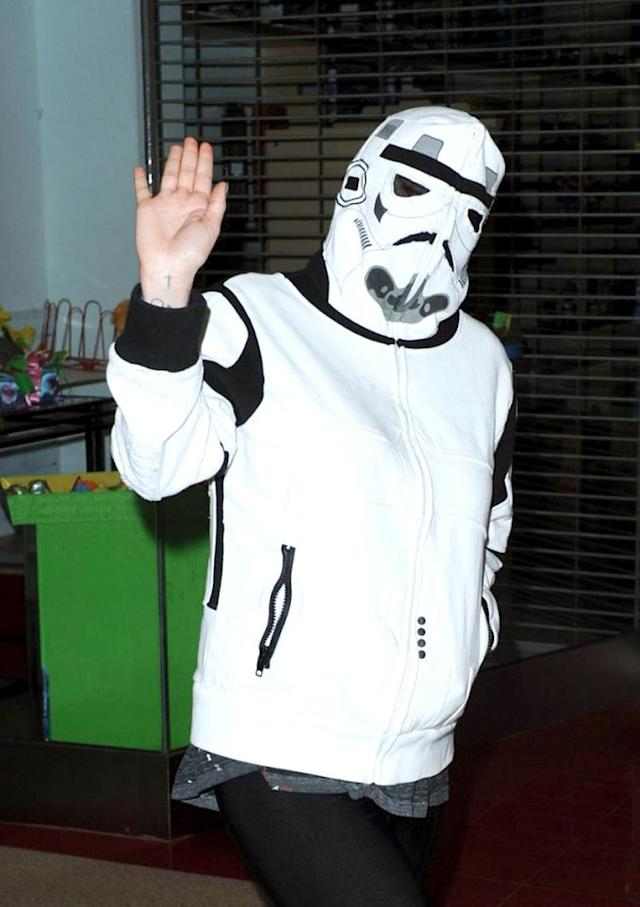 <p>With a wardrobe that rivals Lady Gaga's for outrageousness, the artist formerly known as Ke$ha, can't do much more to raise eyebrows in that department. But she managed to surprise when she shielded herself from the paparazzi in a Stormtrooper costume. (Photo: INF Photo) </p>