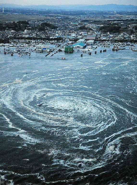 Tsunami swirls near a port in Oarai, Ibaraki Prefecture (state) after Japan was struck by a strong earthquake off its northeastern coast Friday, March 11, 2011. (AP Photo/Kyodo News)