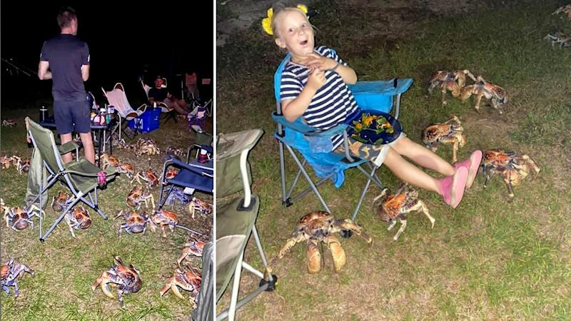 Pictured is the large crabs swarming the camping site. Right is a young girl lifting her legs as she eats and the cabs inch closer to her feet.