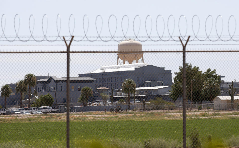 FILE - This July 23, 2014, file photo shows the closed Florence State Prison, a state prison in Florence, Ariz. The number of inmates in Arizona's prisons and in some county jails in the state have decreased since the start of pandemic. The decrease reflects a slowdown in the state's court system that has held far fewer criminal jury trials over the last year as it took steps to prevent the coronavirus from spreading at courthouses. (AP Photo/File)