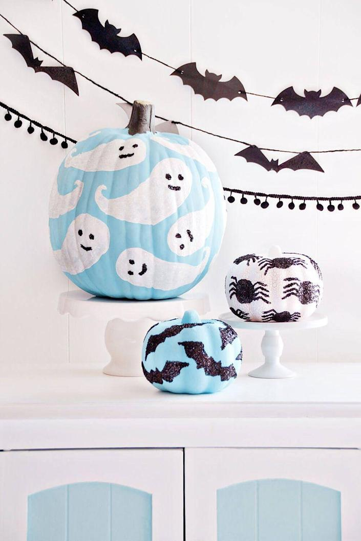 """<p>Add glitter on top of painted designs for an easy way to make your pumpkin sparkle. </p><p><em><strong>Get the tutorial from <a href=""""https://www.iheartnaptime.net/glitter-pumpkins/"""" rel=""""nofollow noopener"""" target=""""_blank"""" data-ylk=""""slk:I Heart Naptime"""" class=""""link rapid-noclick-resp"""">I Heart Naptime</a>.</strong></em> </p><p><a class=""""link rapid-noclick-resp"""" href=""""https://www.amazon.com/Supplies-Resistant-Polyester-Eyeshadow-Assorted/dp/B076J9RD8P/?tag=syn-yahoo-20&ascsubtag=%5Bartid%7C10070.g.1902%5Bsrc%7Cyahoo-us"""" rel=""""nofollow noopener"""" target=""""_blank"""" data-ylk=""""slk:SHOP GLITTER"""">SHOP GLITTER</a> <strong><br></strong></p>"""