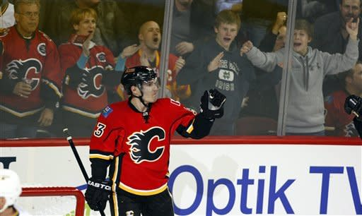 Calgary Flames' Mike Cammalleri celebrates his goal during second period NHL hockey action against the Dallas Stars in Calgary, Alberta, Monday, March 26, 2012. (AP Photo/The Canadian Press, Jeff McIntosh)
