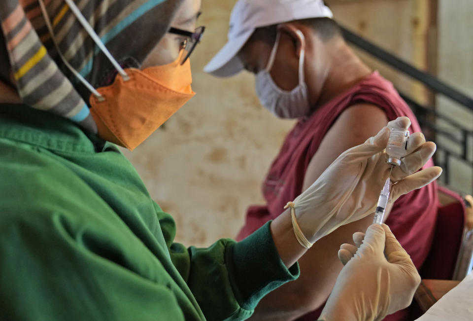 A health worker prepares a shot of the Sinovac COVID-19 vaccine during a mass vaccination in Jakarta, Indonesia, Monday, June 21, 2021. Indonesia's president ordered authorities to speed up the country's vaccination campaign as the World Health Organization warned of the need to increase social restrictions in the country amid a fresh surge of coronavirus infections caused by worrisome variants. (AP Photo/Dita Alangkara)