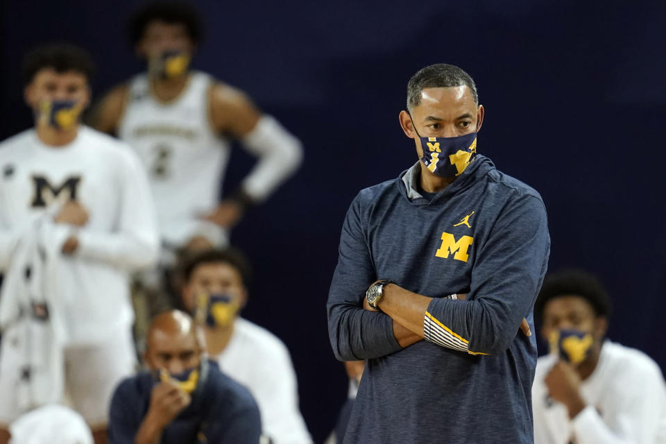 FILE - In this Dec. 2, 2020, file photo, Michigan head coach Juwan Howard watches in the first half of an NCAA college basketball game against Ball State in Ann Arbor, Mich. Third-ranked Michigan finally returns to the court this weekend for the first time in over three weeks, and the Big Ten leaders will hope their virus-induced layoff hasn't knocked them out of the impressive groove the Wolverines were in. (AP Photo/Paul Sancya, File)