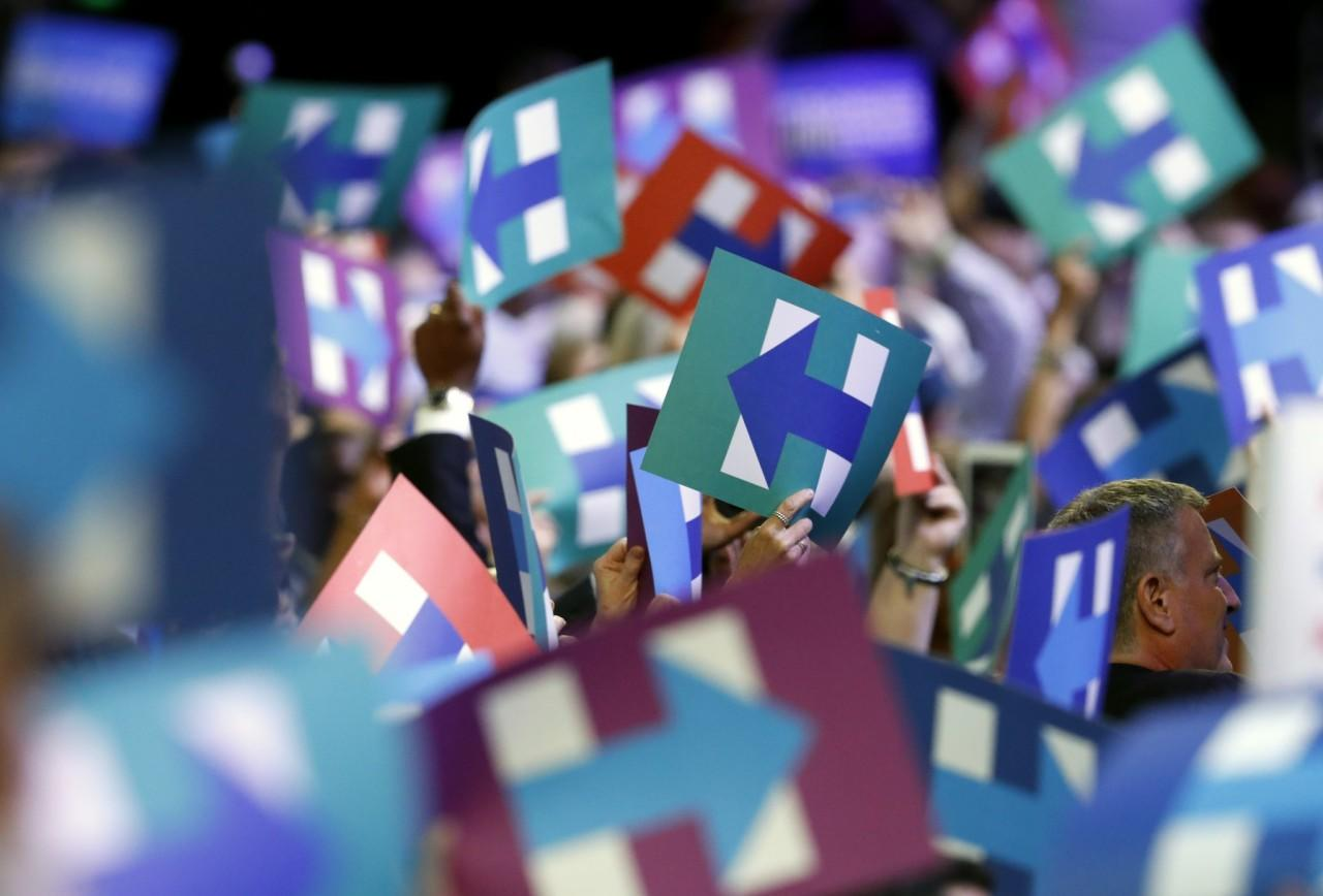 Hillary Clinton campaign signs are held by the crowd during the second day of the Democratic National Convention in Philadelphia , Tuesday, July 26, 2016. (Photo: Paul Sancya/AP)
