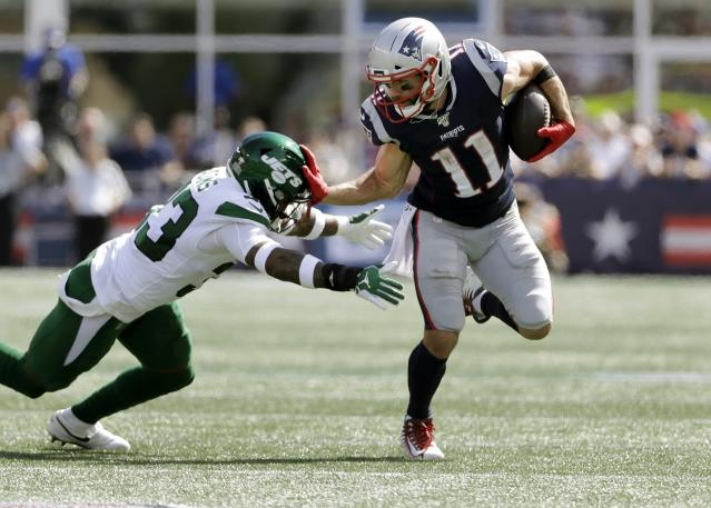 New England Patriots wide receiver Julian Edelman, right, tries to escape the grasp of New York Jets safety Jamal Adams in the first half of an NFL football game, Sunday, Sept. 22, 2019, in Foxborough, Mass. (AP Photo/Steven Senne)