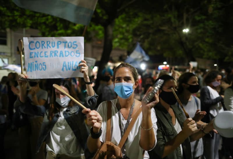 Demonstrators protest against new restrictions amid a rise in coronavirus disease (COVID-19) cases in Buenos Aires
