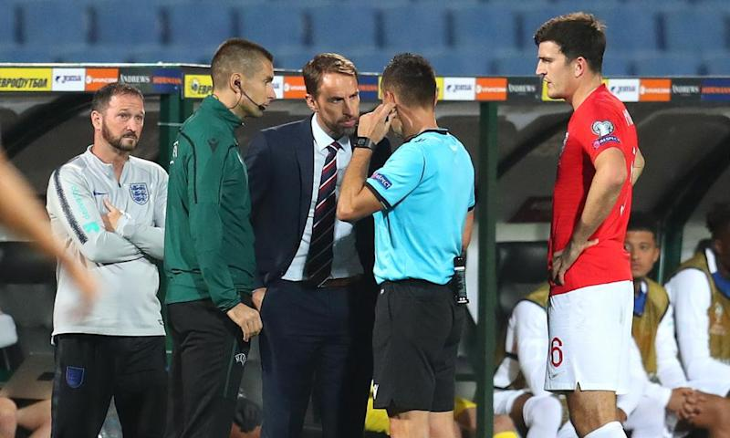England's manager, Gareth Southgate, speaks to the referee during the qualifier in Bulgaria that was halted because of racism last October.