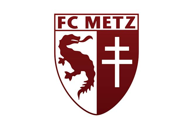 <p>The badge of Oguchi Onyewu's first pro club is highlighted by the Graoully dragon, which supposedly terrorized local residents until driven into the river by St. Clement of Metz during the early days of Christianity. The dragon has been a city symbol for some 1,000 years. On the right is the Cross of Lorraine, a symbol of French patriotism and liberation during World War II. Metz is Lorraine's most populous city. Feelings toward the Germans were strong before the war as well, when Metz club officials decided to change from the city's black-and-white colors—which also were associated with the German national team—to the deep red used by one of the club's earlier incarnations.</p>