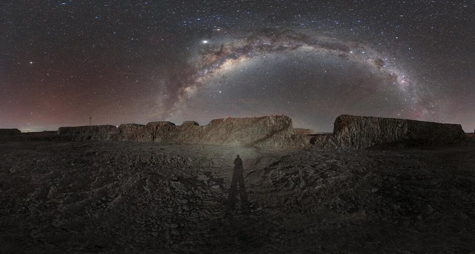 "In this stunning night sky photo, the full arc of the Milky Way galaxy glitters over a photographer's shadow at the construction site for the European Southern Observatory's Extremely Large Telescope (ELT), on the Chilean mountain Cerro Armazones. Scheduled to open in 2025, ELT will be ""the world's biggest eye on the sky,"" with a 39-meter (128-foot) primary mirror. ELT will scan the skies in optical and near-infrared wavelengths of light to search for worlds beyond our solar system, particularly for potentially Earth-like exoplanets. It will also help astronomers study how planets, stars, galaxies and black holes formed in the early universe."
