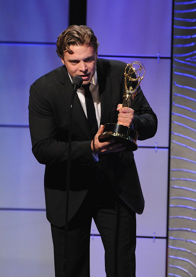 "BEVERLY HILLS, CA - JUNE 16:  Actor Billy Miller accepts the Outstanding Supporting Actor in a Drama Series award for ""The Young and the Restless"" onstage during The 40th Annual Daytime Emmy Awards at The Beverly Hilton Hotel on June 16, 2013 in Beverly Hills, California.  (Photo by Kevin Winter/Getty Images)"