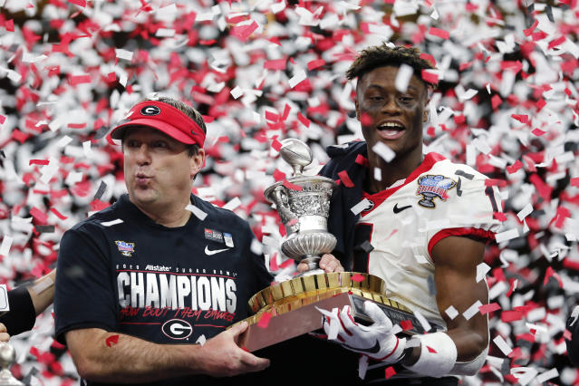 Georgia head coach Kirby Smart and wide receiver George Pickens (1), MPV for the game, hoist the trophy after the Sugar Bowl NCAA college football game against Baylor in New Orleans, Wednesday, Jan. 1, 2020. Georgia won 26-14. (AP Photo/Brett Duke)
