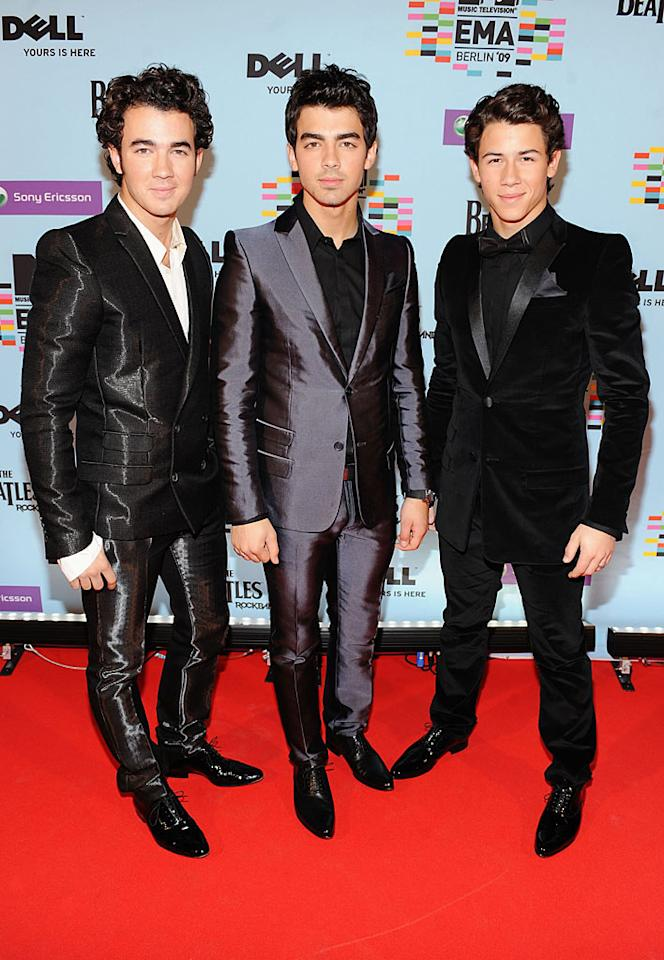 """At the 2009 MTV Europe Music Awards, Kevin and Joe Jonas sported shiny and snug suits, while their little brother Nick opted for a cheesy velvet tux. Needless to say, they all made major mistakes. Kevin Mazur/<a href=""""http://www.wireimage.com"""" target=""""new"""">WireImage.com</a> - November 5, 2009"""