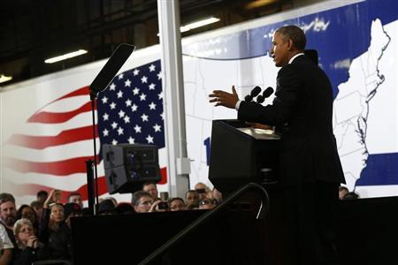 U.S. President Barack Obama speaks about the economy and fuel standards during a visit to a Safeway Distribution Center in Upper Marlboro, Maryland February 18, 2014. REUTERS/Kevin Lamarque