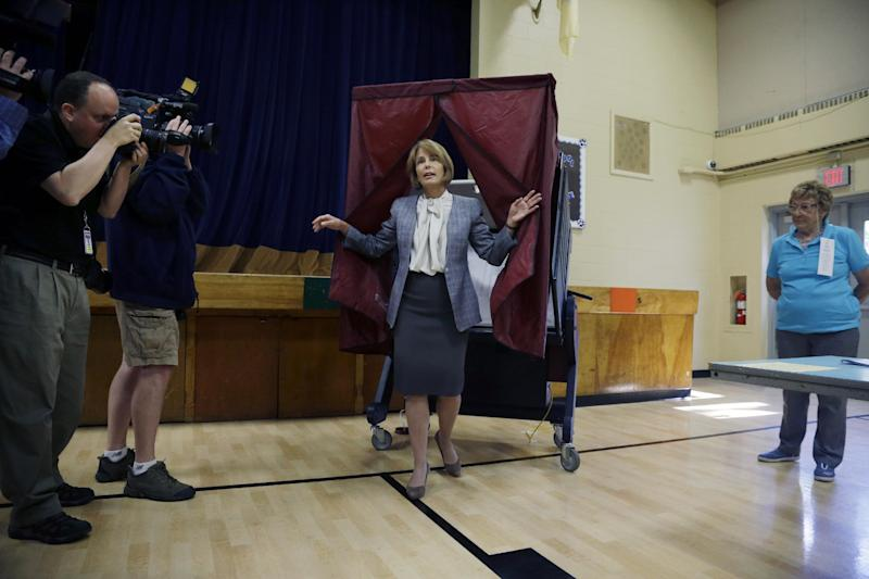 Democratic candidate for New Jersey governor, state Sen. Barbara Buono, steps from the booth after casting her primary election vote Tuesday, June 4, 2013 in Metuchen, N.J. (AP Photo/Mel Evans)