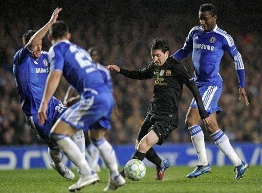 Barcelona's Argentine forward Lionel Messi (C) vies for the ball with Chelsea's Nigerian midfielder John Obi Mikel (R) and English defender John Terry (L) during the UEFA Champions League semi-final first leg football match at Stamford Bridge in London. Chelsea won 1-0