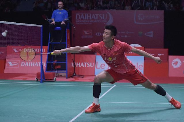 Chen Long of China allowed a younger, nimbler colleague chances to get the better of net exchanges (AFP Photo/ADEK BERRY)