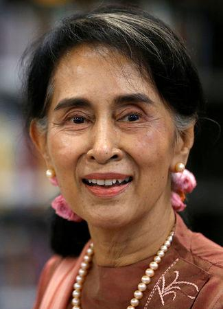 FILE PHOTO: Myanmar's State Counsellor Aung San Suu Kyi smiles as she speaks to students in a round-table discussion on a visit to Roosevelt High School in Washington, DC, U.S., September 15, 2016. REUTERS/Jonathan Ernst/File Photo
