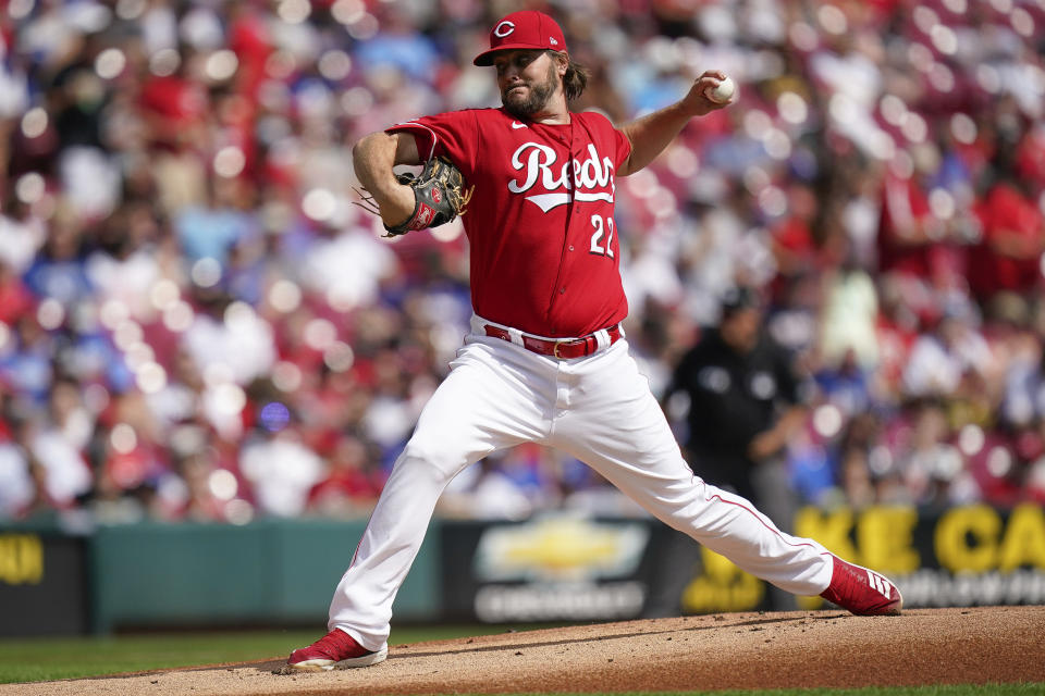 Cincinnati Reds starting pitcher Wade Miley (22) delivers during the first inning of a baseball game against the Los Angeles Dodgers in Cincinnati, Sunday, Sept 19, 2021. (AP Photo/Bryan Woolston)