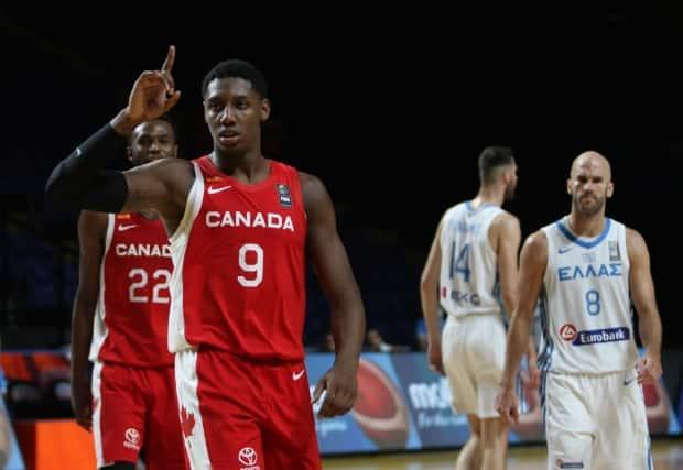 Canada's RJ Barrett celebrates after a 97-91 win over Greece in the FIBA Men's Olympic Qualifying tournament on Tuesday. (Chad Hipolito/The Canadian Press - image credit)