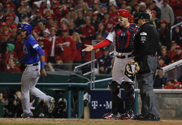 Javier Baez should have been ruled out on a pivotal play in Game 5 of the NLDS. (AP Photo/Pablo Martinez Monsivais)
