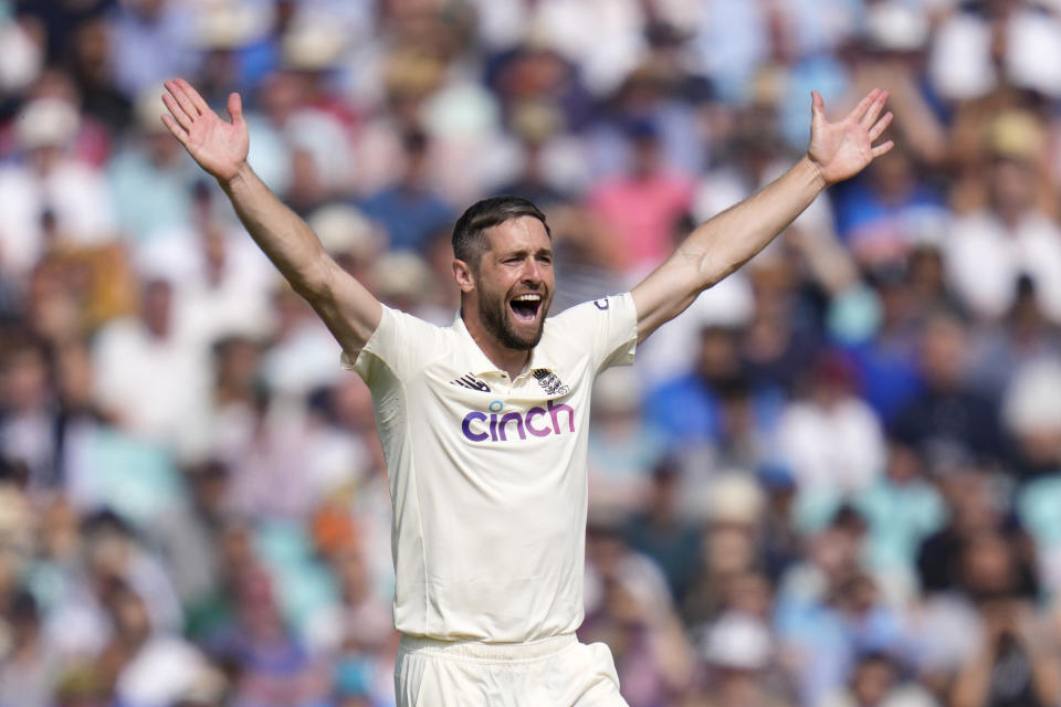 England's Chris Woakes celebrates taking the wicket of India's Ravindra Jadeja on day four of the fourth Test match at The Oval cricket ground in London, Sunday, Sept. 5, 2021. (AP Photo/Kirsty Wigglesworth)