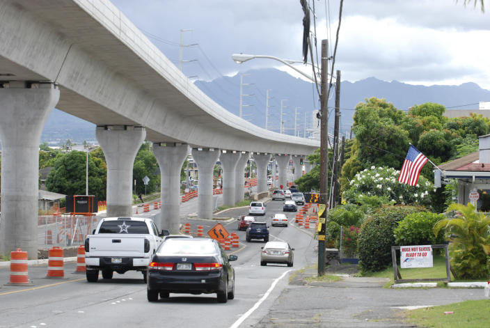 FILE - In this May 18, 2017, file photo, a rail line under construction winds through the Honolulu suburb of Aiea, Hawaii. Honolulu is building one of the nation's most expensive rail lines to address some of the nation's worst traffic but tax revenue declines during the pandemic and spiraling costs mean it doesn't currently have enough money to finish the 20-mile route as planned. (AP Photo/Cathy Bussewitz, File)