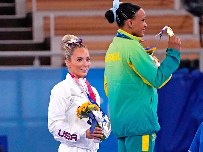 MyKayla Skinner and Rebeca Andrade pose with their medals after the Tokyo Olympics women's vault final.