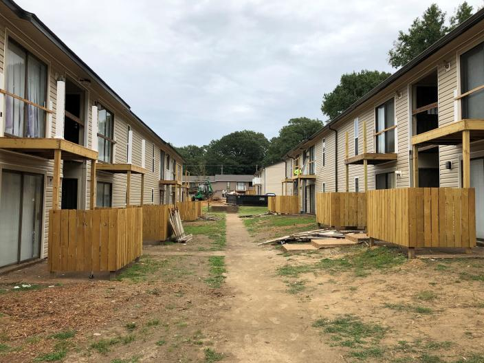 FILE - In this Sept. 22, 2020, file photo buildings at Hunter Oaks Apartments undergo renovations in Memphis, Tenn. Owners of the apartment complex are among seven landlords who manage or own more than 5,000 rental units and have filed a lawsuit claiming that a national eviction moratorium has not only placed them under unfair financial strain, but also infringed on their rights as property owners. The Centers for Disease Control and Prevention federal eviction moratorium initially put in place last year, provides protection for renters out of concern that having families lose their homes and move into shelters or share crowded conditions with relatives or friends during the pandemic would further spread the highly contagious virus. (AP Photo/Adrian Sainz, File)